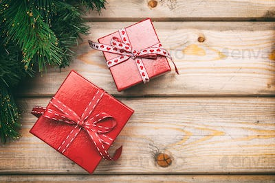 Christmas gift boxes on wooden background, copy space, top view