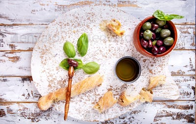Olives with oil and bread sticks