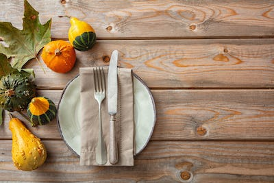 Thanksgiving flat lay with colorful pumpkins and place setting