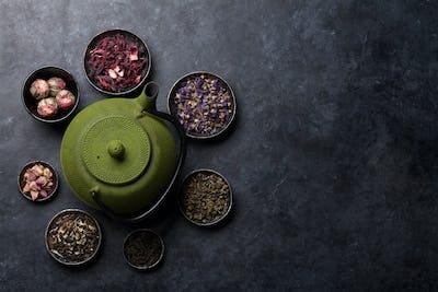 Various dry tea and tea pot