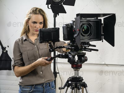 Beautiful woman operating a video camera rig