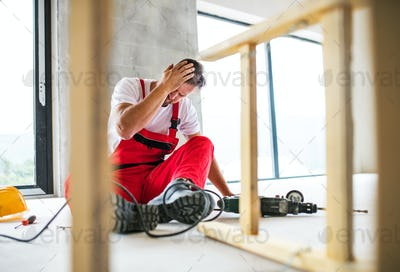 An accident of a man worker at the construction site.