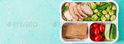 Healthy green meal prep containers with chicken fillet, rice, brussels sprouts