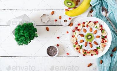 Vegan almond milk chia seeds pudding  with banana and kiwi.