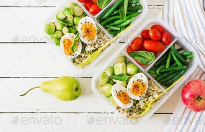 Vegetarian meal prep containers with eggs, brussel sprouts, green beans and tomato.