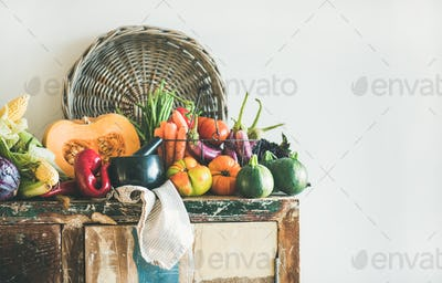 Assortment of Fall vegetables for cooking on cupboard, copy space