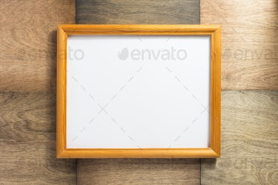 photo frame at wooden background