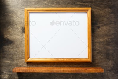 picture frame at wooden background