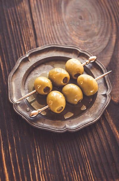 Olive skewer on the vintage plate