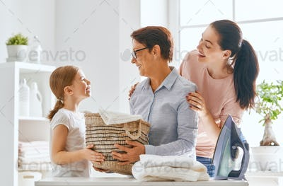 family doing laundry at home