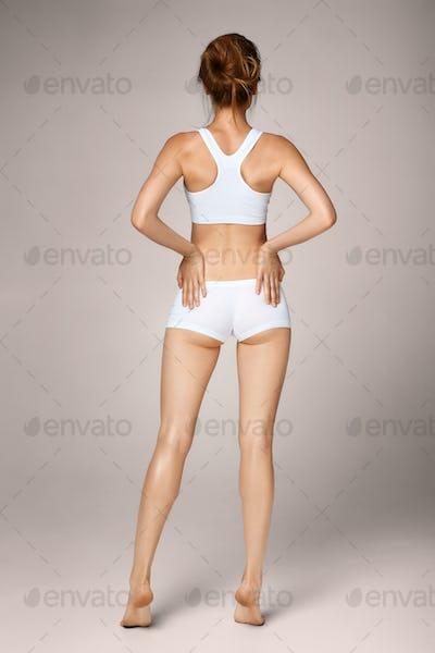 Backbone pain. Portrait of young female suffering from backache