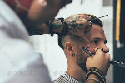 Customer getting ready in barbershop