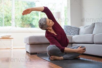 Mature woman in yoga pose