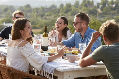 Group Of Young Friends Enjoying Outdoor Meal On Holiday
