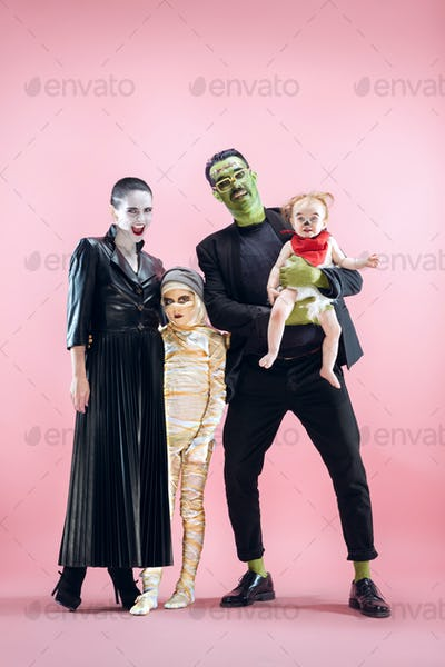 Halloween Family. Happy Father, Mother and Children Girls in Halloween Costume and Makeup