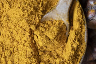 Wooden Spoon with Turmeric Powder