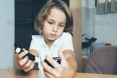 Diabetic child measures sugar level