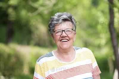 happy  senior woman with eyeglasses