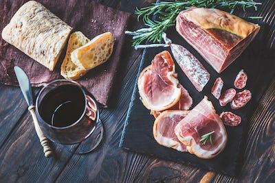 Red wine with prosciutto ham
