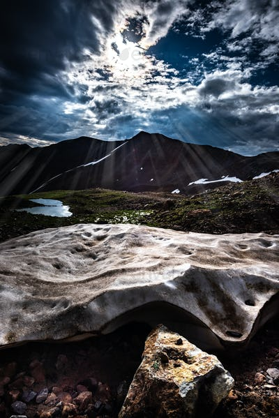 Sun Shines on a chunk of snow Colorado Mountains