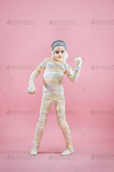 Studio image of a young teen girl man bandaged,
