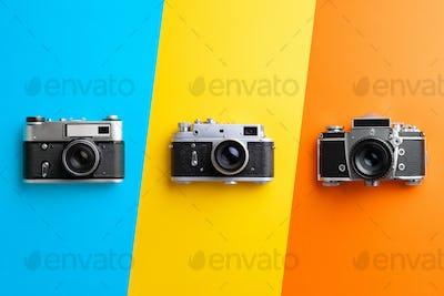Multiple vintage cameras