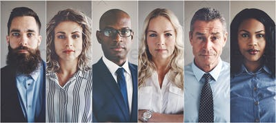 Focused group of ethnically diverse professional businessmen and businesswomen