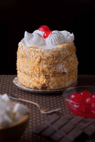 meringue cake against dark background