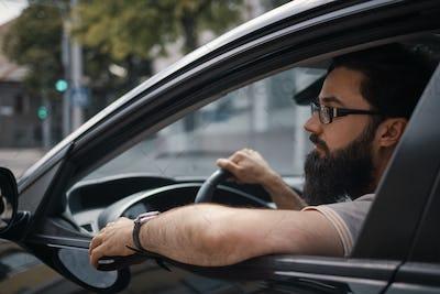 Confident man driving a car