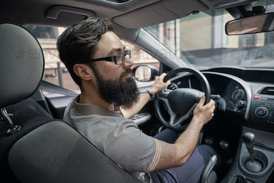 Handsome man driving the car