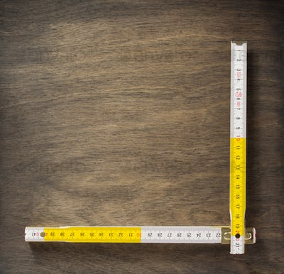 meter ruler on wood