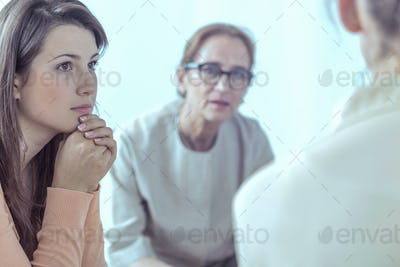 Woman and psychotherapist during meeting of support group