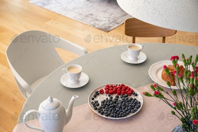 Real photo with high angle of dining table with fresh flowers, j