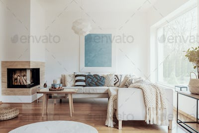 Modern corner fireplace in a sunny, peaceful living room interio