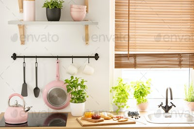 Real photo of wooden countertop with fresh plants, board with cr