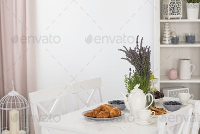 Real photo of dining table with lavender, fresh fruits, croissan