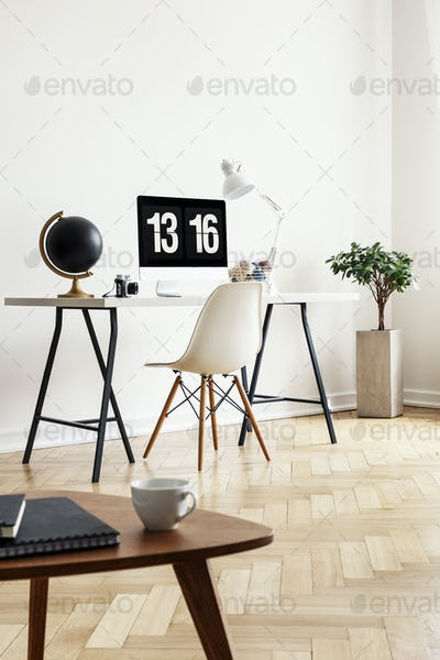 Real photo of a coffee table with notebooks and cup with a desk,