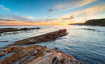Sunrise over the beach at Cove in Scotland