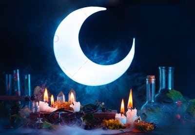 Halloween header with shining full Moon. Witch or wizard workplace with burning candles. Spooky
