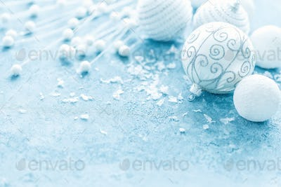 Christmas decorations on frosty background. Festive card with Christmas decorations