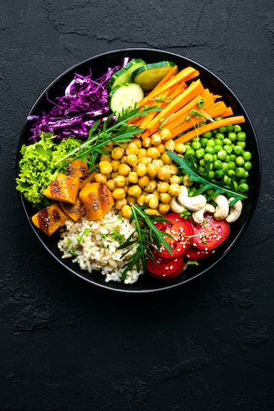 Bowl dish with brown rice, vegetables and chickpea