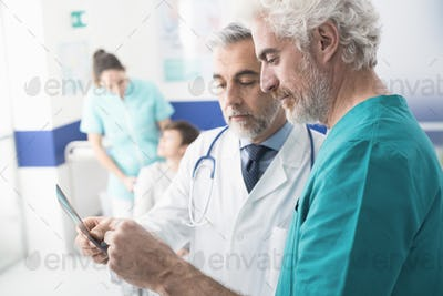 Professional doctors examining patient's x-ray