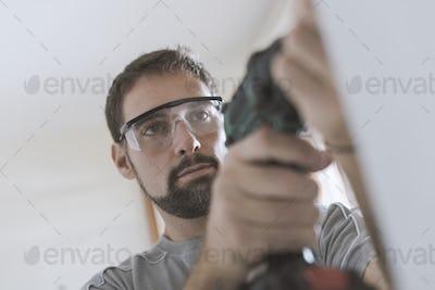 Professional repairman using a drill