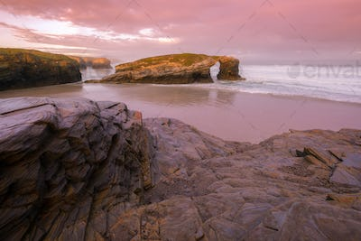 Dawn with violet tints on the famous beach of As Catedrais