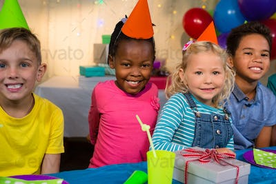 Portrait of smiling children at birthday party