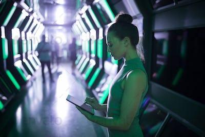 Female executive using digital tablet