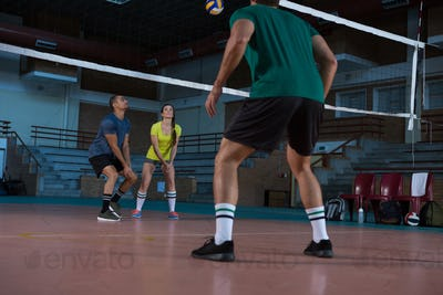 Full length of players practicing volleyball
