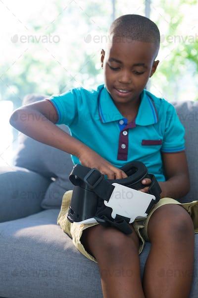 Boy adjusting virtual reality headset at home
