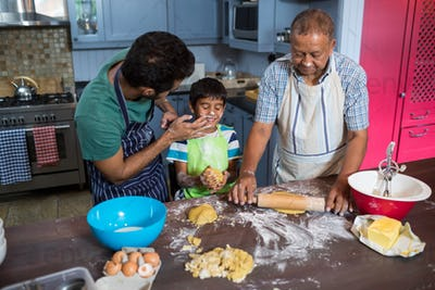 High angle view of playful family preparing food