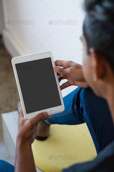Man using digital tablet at office